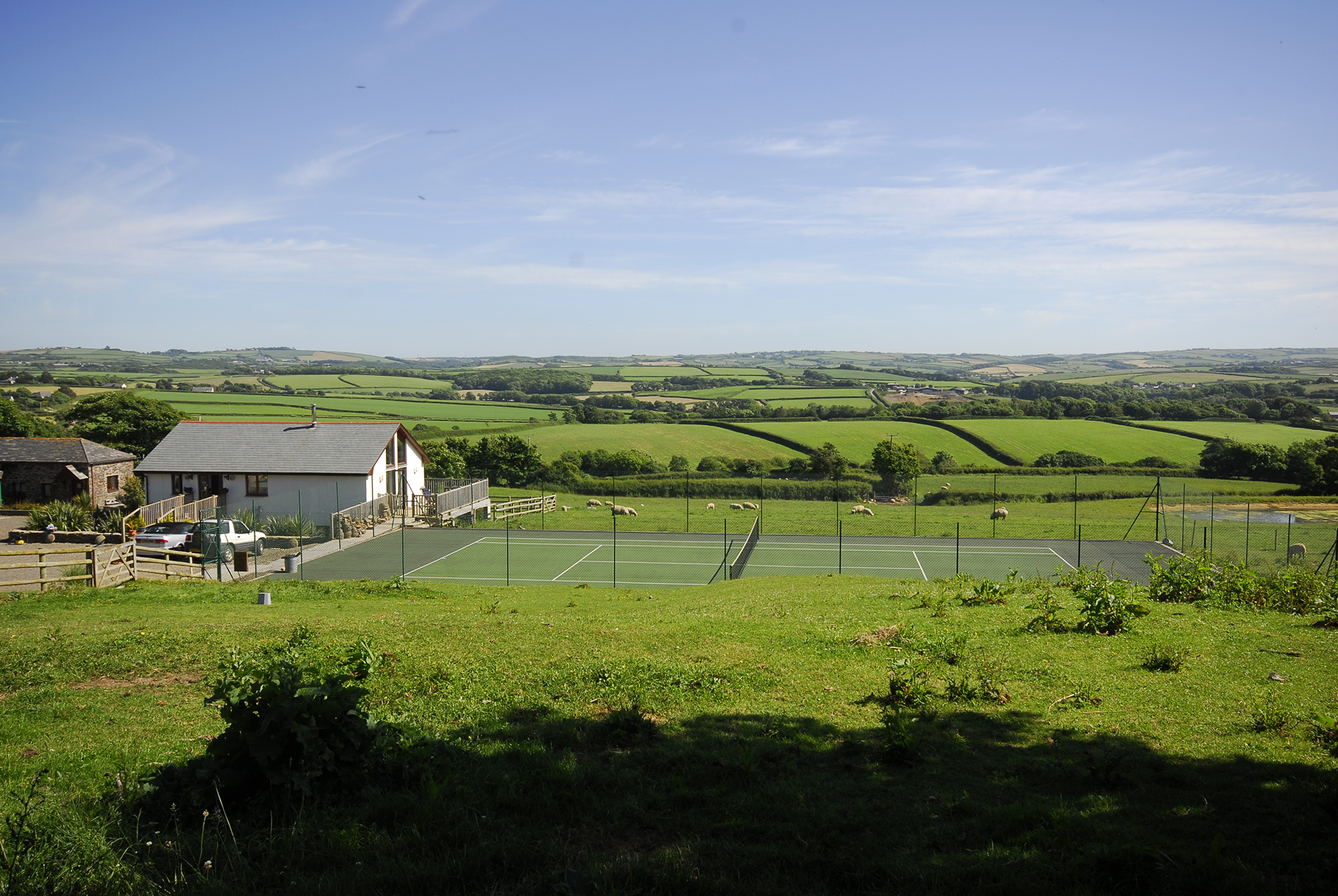 Take in stunning views on site over the countryside towards the coast.