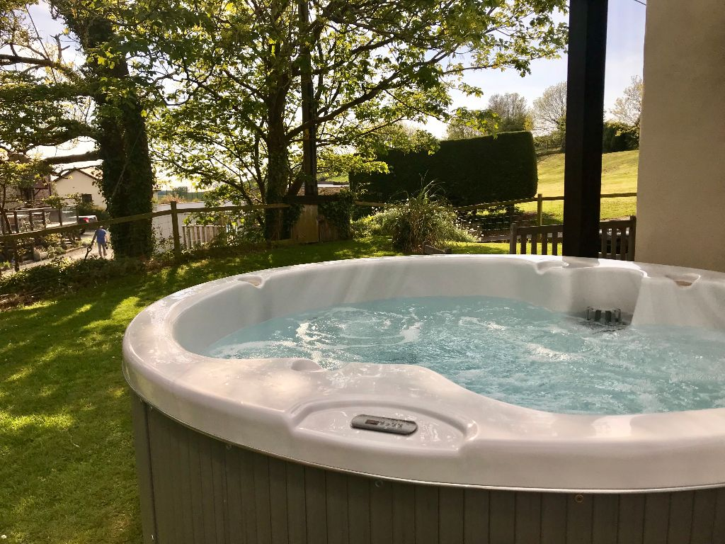 Relax in the private hot tub in the garden at Parsons cottage.