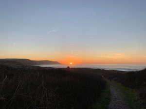 The sun setting over the Atlantic at Widemouth Bay